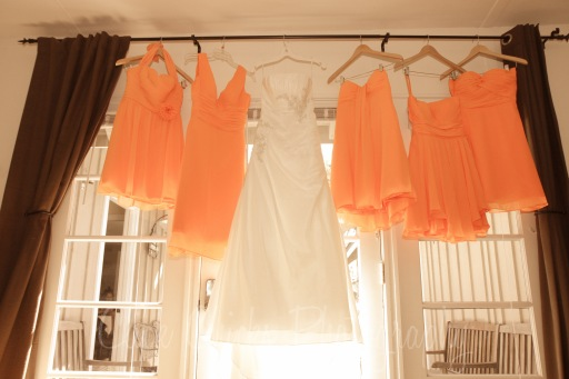 Yes, they're certainly tangerine. I love it when bridesmaids wear different styles.