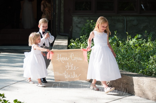 The flower girls and ring bearer are the officiant's children. They traveled from Aspen to be there.