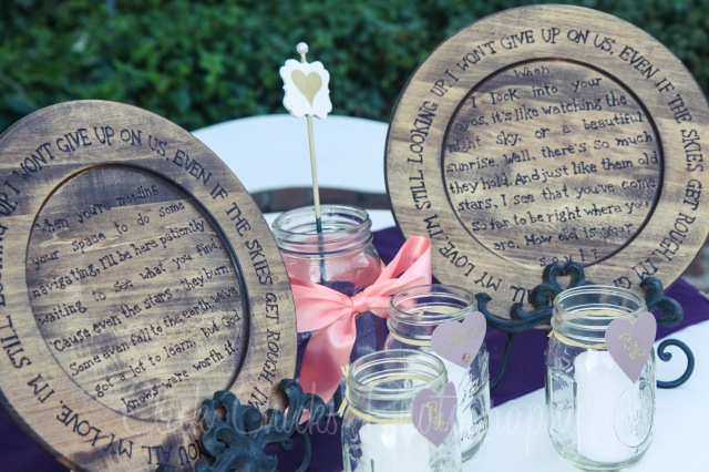 Custom wood-burned chargers with the lyrics to their first dance song.