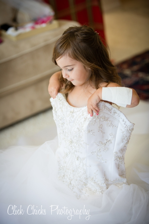 Kristin's sweet, sweet, sweet daughter checking out Mommy's gown.