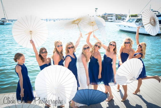 On the dock at the Balboa Yacht Club. Girls love to have fun with parasols :-)
