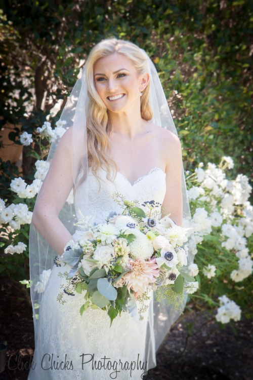 So pretty. The white iceberg roses are the perfect backdrop for a wedding portrait.